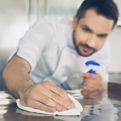 Chef Cleaning in the Kitchen